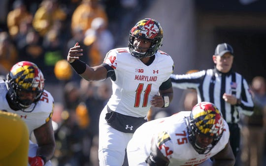 Maryland quarterback Kasim Hill motions to a running back prior to taking the snap against Iowa on Saturday, Oct. 20, 2018, at Kinnick Stadium in Iowa City.