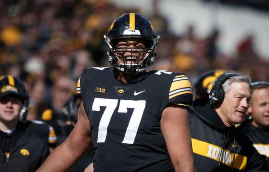 Iowa left tackle Alaric Jackson gets pumped up after members of the Hawkeyes defense recovered a fumble in the end zone against Maryland on Saturday, Oct. 20, 2018, at Kinnick Stadium in Iowa City.