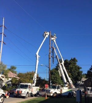Indianapolis Power & Light crews work to repair a damaged power line Sunday.