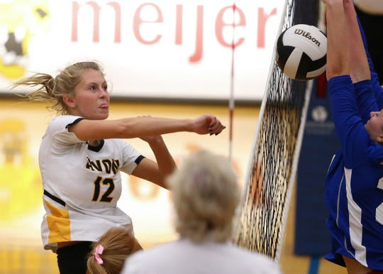 Avon's Isabella Stallard spikes the ball against Roncalli's during the regional semifinals at Greenfield-Central High School in Greenfield, Ind., Saturday, Oct. 20, 2018. Avon defeated Roncalli 3-1 to take the regional champ title.