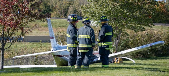 Pike Township firefighters respond to the crash scene.