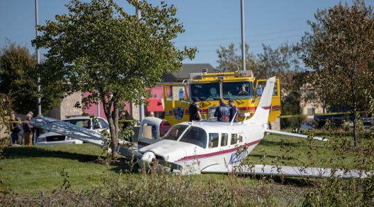 The plane came to rest in a ditch near the parking lot.