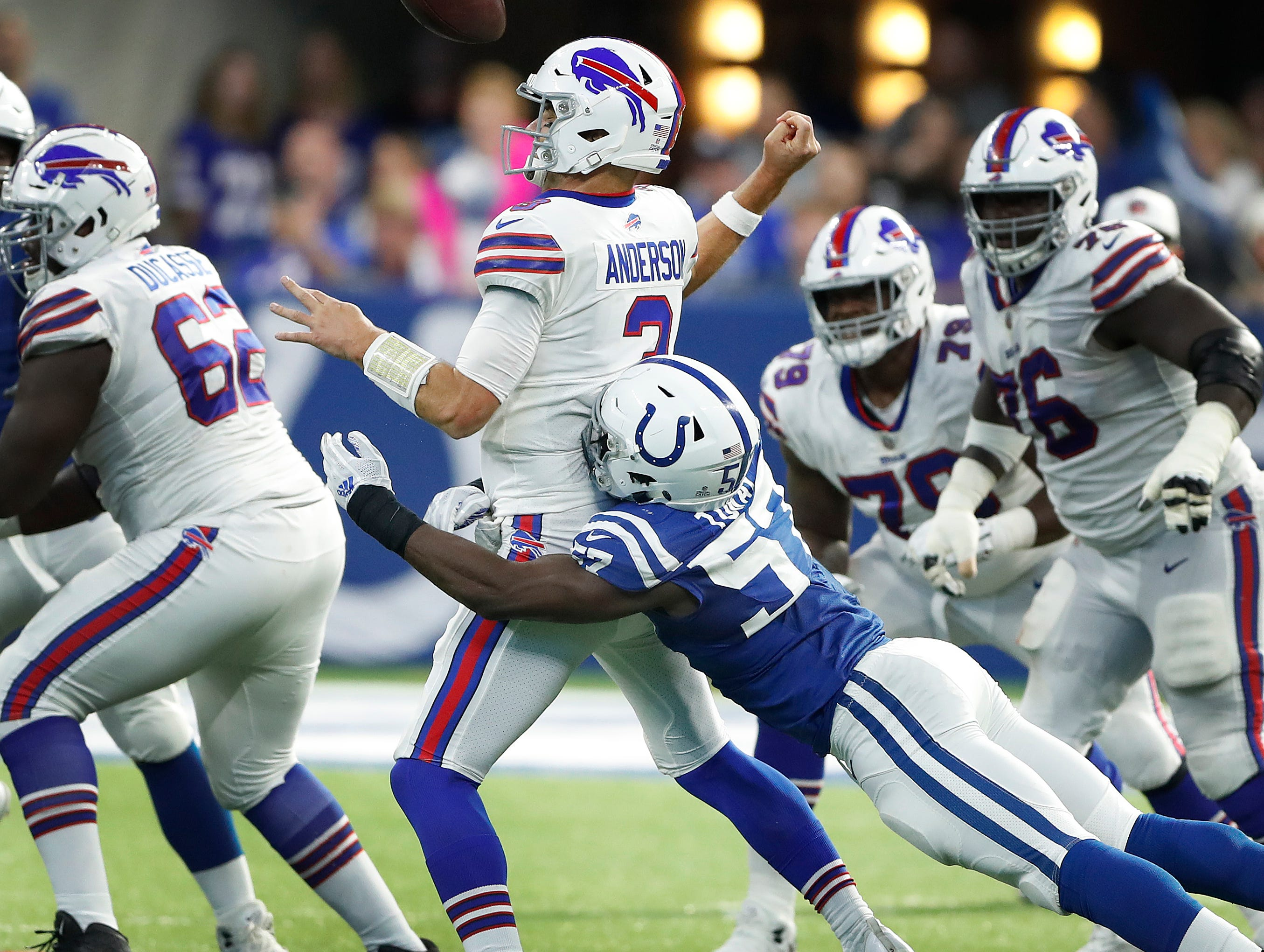 Indianapolis Colts defensive end Kemoko Turay (57) strip sacks Buffalo Bills quarterback Derek Anderson (3) in the second half of their game against the Buffalo Bills on Sunday, Oct 21, 2018. The Colts defeated the Bills 37-5.