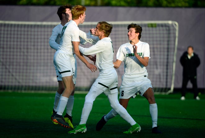 The Zionsville Eagles celebrate during their IHSAA 3A semistate soccer match against the Bloomington South Panthers at Seymour High School in Seymour, Ind., on Saturday, Oct. 20, 2018.