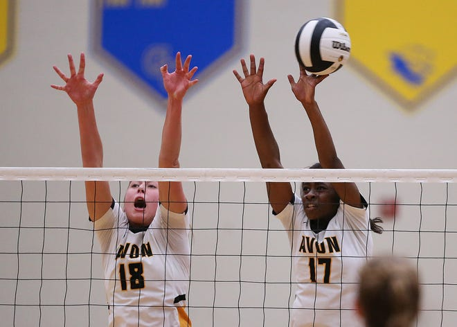 Holly Eastridge, left in this file photo, got the kill on Saturday that sent the Avon Orioles to state for the second straight season. At right is Aderinola Adewopo.