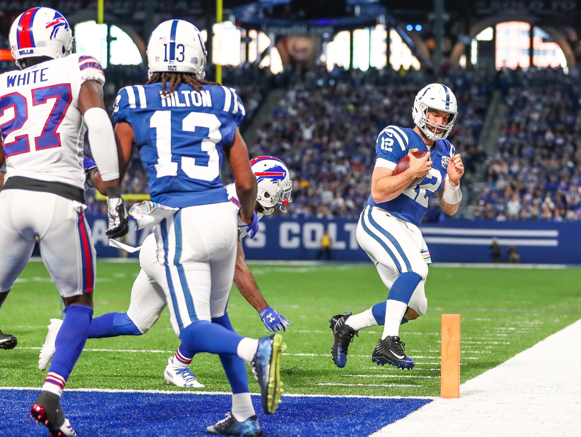 Indianapolis Colts quarterback Andrew Luck (12) steps out of bounds at the one yard line late in the game against the Buffalo Bills at Lucas Oil Stadium on Sunday, Oct. 21, 2018.