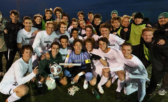The Zionsville Eagles pose with their semistate plaque after winning the IHSAA 3A semistate soccer match against the Bloomington South Panthers at Seymour High School in Seymour, Ind., on Saturday, Oct. 20, 2018.