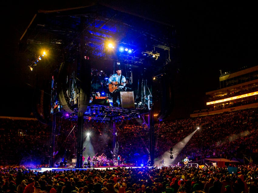 Garth Brooks performs before a sold-out crowd at Notre Dame Stadium Saturday, Oct. 20, 2018, in South Bend, Ind. (Robert Franklin/South Bend Tribune via AP)