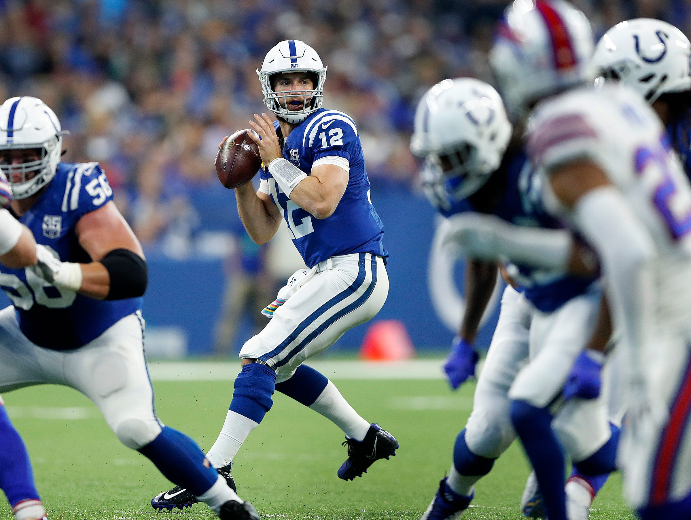 Indianapolis Colts quarterback Andrew Luck (12) drops back to pass in the first half of their game against the Buffalo Bills on Sunday, Oct 21, 2018.
