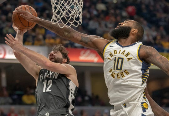 Joe Harris of the Brooklyn Nets has this shot blocked by Kyle O'Quinn of the Indiana Pacers,. Bankers Life Fieldhouse, Indianapolis, Saturday, Oct. 20, 2018. Indiana won 132-112.