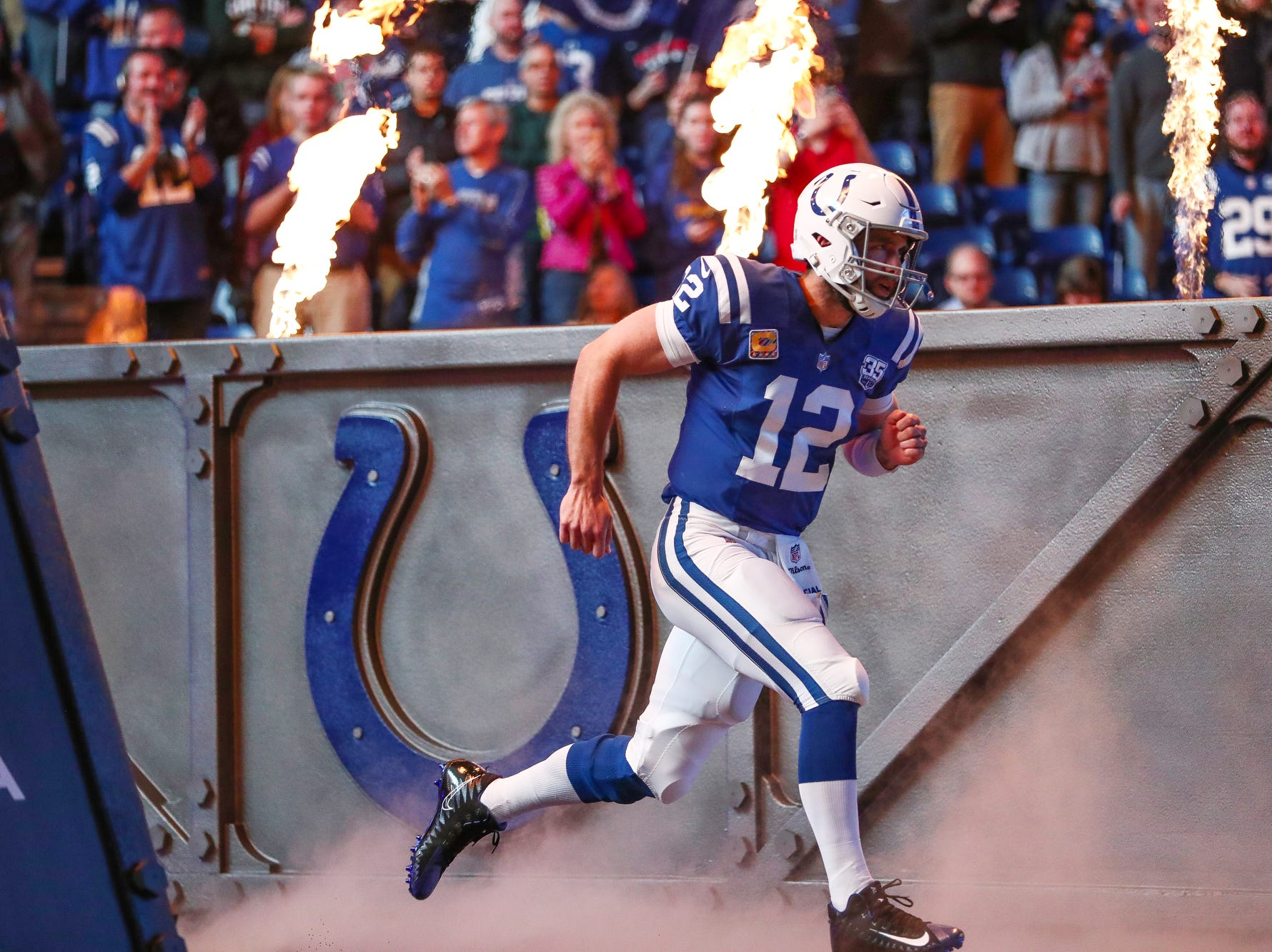 Indianapolis Colts quarterback Andrew Luck (12) makes his way onto the field before the Buffalo Bills game at Lucas Oil Stadium on Sunday, Oct. 21, 2018.