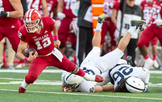 Indiana quarterback Peyton Ramsey (12) makes a run into first-down territory during the second half of an NCAA college football game against Penn State Saturday, Oct. 20, 2018, in Bloomington, Ind. Penn State won 33-28. (AP Photo/Doug McSchooler)