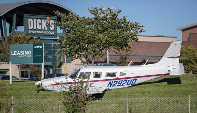 Pilot Greg Mahler made an emergency landing of his Piper P32R at the Traders Point Shopping Plaza in Indianapolis on Sunday.