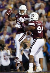 Mississippi State cornerback Cameron Dantzler (3) reacts with defensive tackle Jeffery Simmons (94) after intercepting the ball during an NCAA college football game against LSU in Baton Rouge, La., Saturday, Oct. 20, 2018. (AP Photo/Tyler Kaufman)