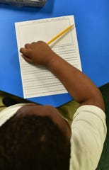 Kindergartner Antroine Anderson waits patiently for assistance from his teacher, April Ketchum, at Linwood Elementary in Vaughan, Miss. Monday, April 23, 2018.