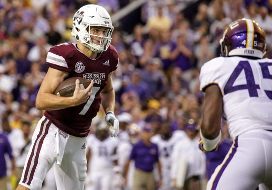 Oct 20, 2018; Baton Rouge, LA, USA; Mississippi State Bulldogs quarterback Nick Fitzgerald (7) runs as LSU Tigers linebacker Michael Divinity Jr. (45) pursues during the first quarter at Tiger Stadium. Mandatory Credit: Derick E. Hingle-USA TODAY Sports