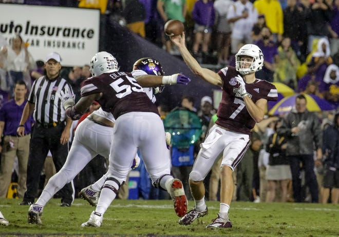 Oct 20, 2018; Baton Rouge, LA, USA; Mississippi State Bulldogs quarterback Nick Fitzgerald (7) passes the football against the LSU Tigers during the second quarter at Tiger Stadium. Mandatory Credit: Derick E. Hingle-USA TODAY Sports