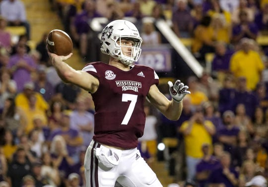 Oct 20, 2018; Baton Rouge, LA, USA; Mississippi State Bulldogs quarterback Nick Fitzgerald (7) throws a pass against the LSU Tigers during the first quarter at Tiger Stadium. Mandatory Credit: Derick E. Hingle-USA TODAY Sports