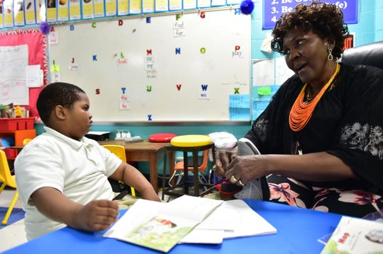 Linwood Elementary kindergartner Antroine Anderson has his shoes tied by teaching assistant Mary Williams. Vaughan, Miss. Monday, April 23, 2018.