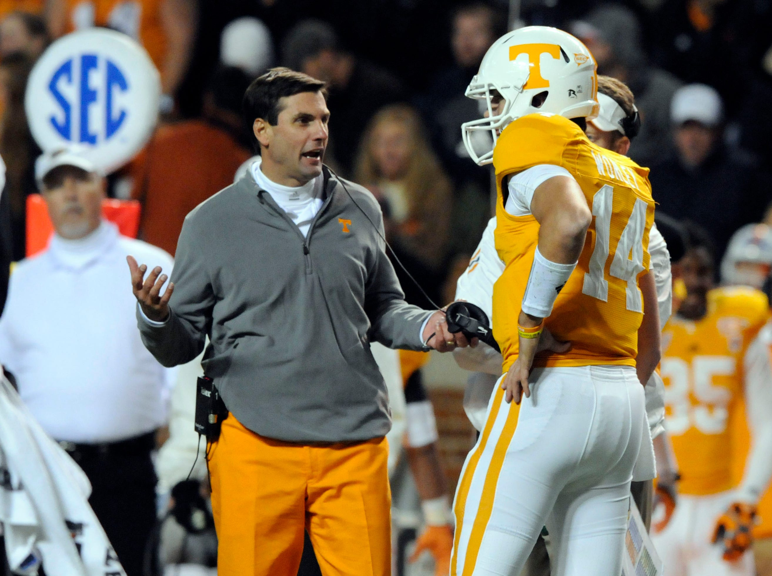 Tennessee head coach Derek Dooley talks with quarterback Justin Worley (14) during first half action against South Carolina at Neyland Stadium Saturday, Oct. 29, 2011.