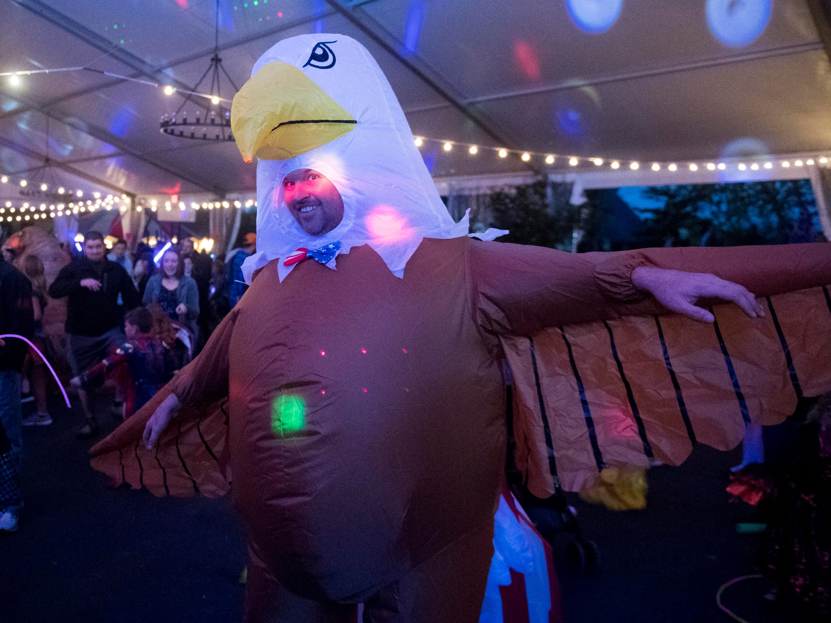An inflated bald eagle costume dances at the Monster Mash dance party during Boo! at the Zoo on Saturday, October 20, 2018.