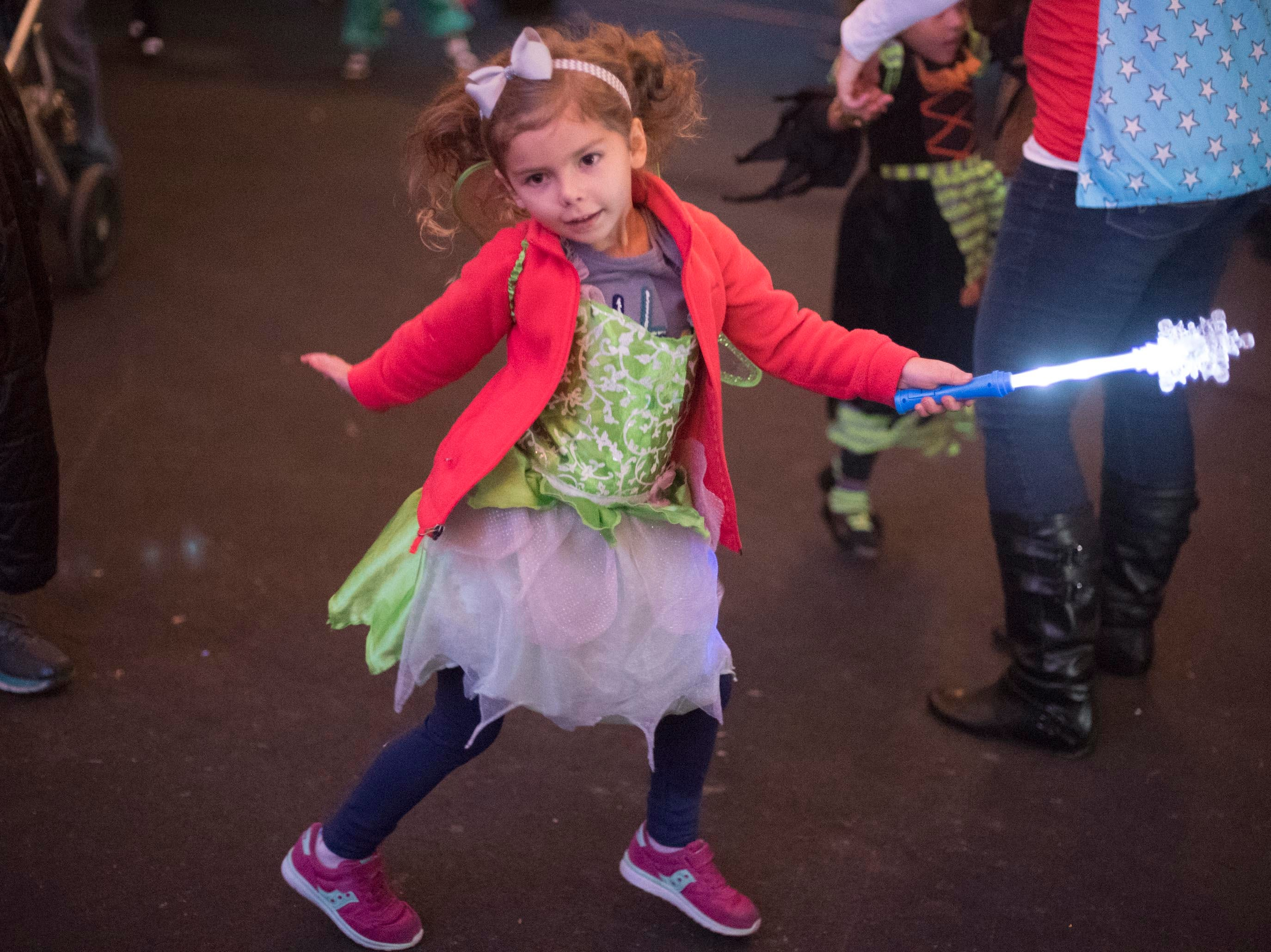 A young trick-or-treater dances at the Monster Mash dance party during Zoo Knoxville's Boo! at the Zoo on Saturday, October 20, 2018.