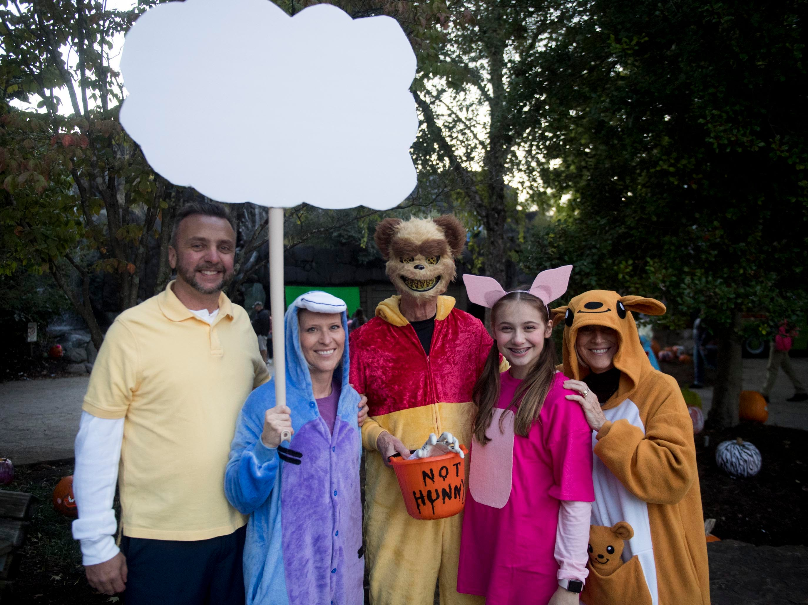 From left, Mark and Amy Burnette, Walt Warren, Emma Burnette and Trish Warren have attended Zoo Knoxville's Boo! at the Zoo for 13 consecutive years on Saturday, October 20, 2018.