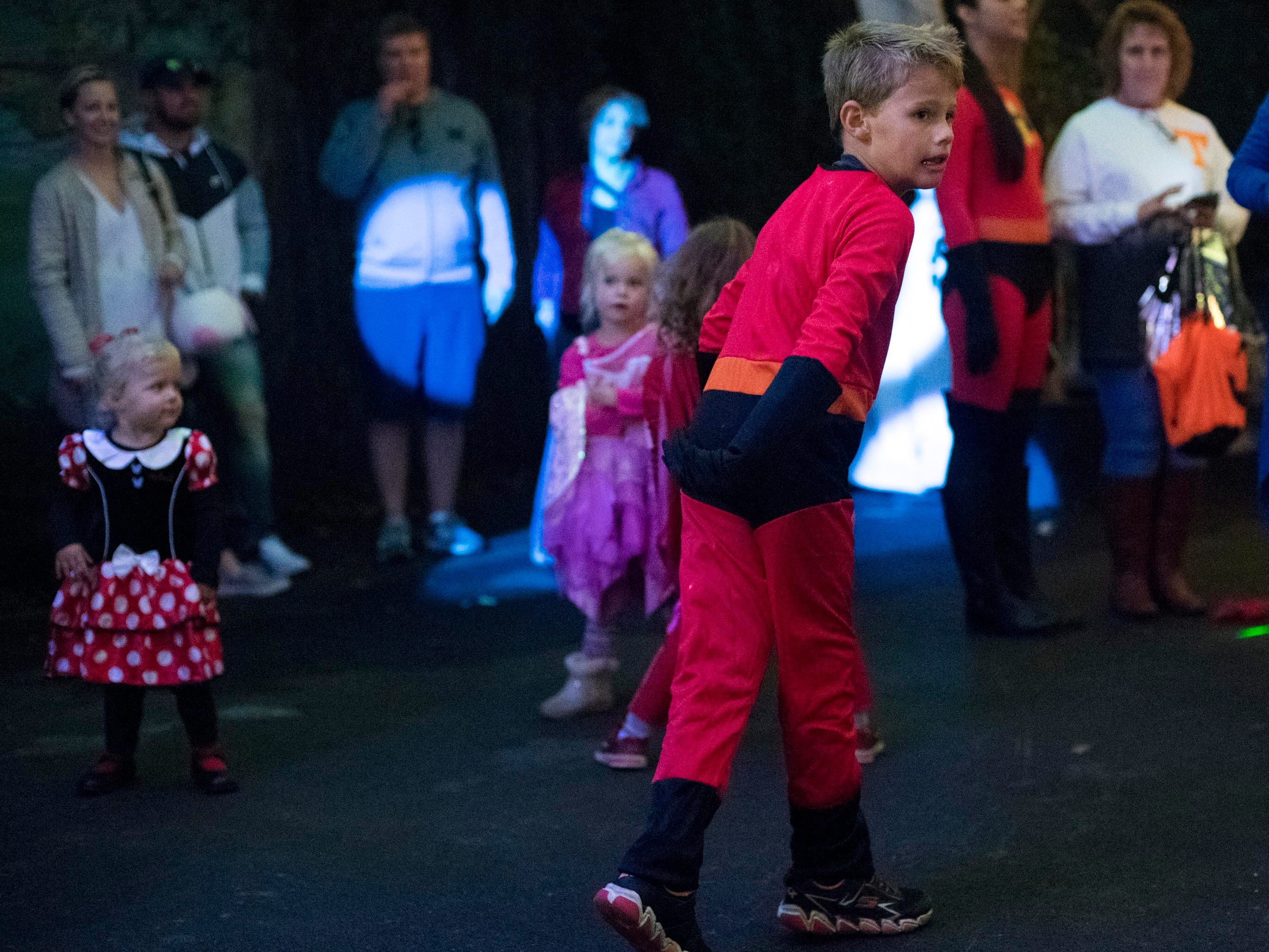 A Incredibles costumed trick-or-treater dancing at the Monster Mash dance party during Boo! at the Zoo on Saturday, October 20, 2018.