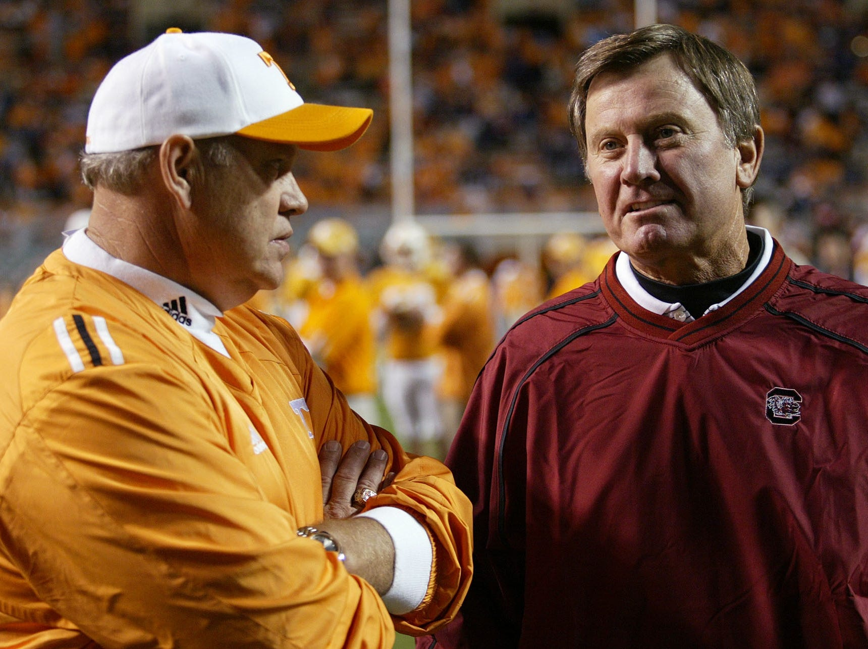 In this Oct. 29, 2005 file photo, South Carolina coach Steve Spurrier, right, talks with Tennessee coach before an NCAA college football game in Knoxville, Tenn. Through most of the 1990s, games between Phillip Fulmer's Tennessee Volunteers and Steve Spurrier's Florida Gators helped decide Southeastern Conference championship and national titles.  On Saturday, the two winningest active coaches in the SEC will be playing for the inside track to fourth place in their division.