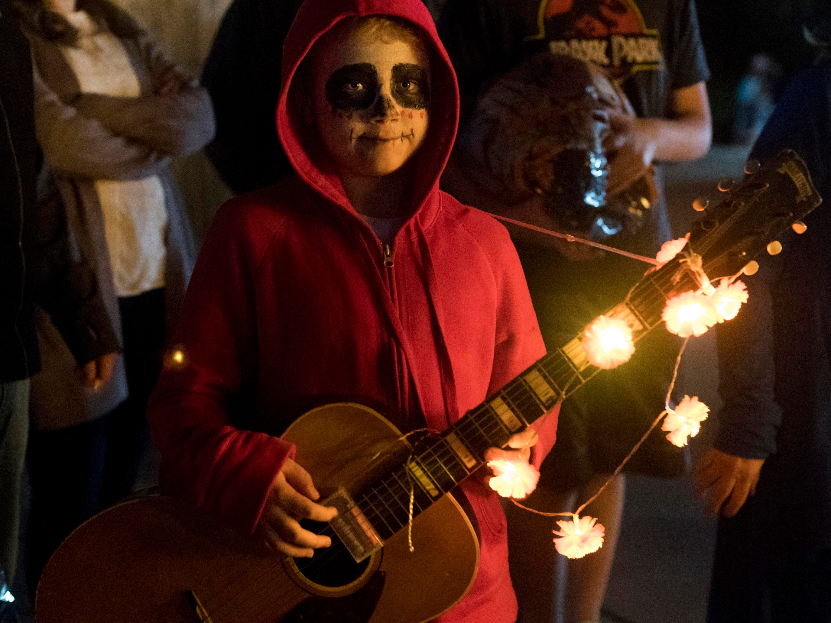 A trick or treater is costumed as Miguel from the movie Coco for Zoo Knoxville's Boo! at the Zoo on Saturday, October 20, 2018.