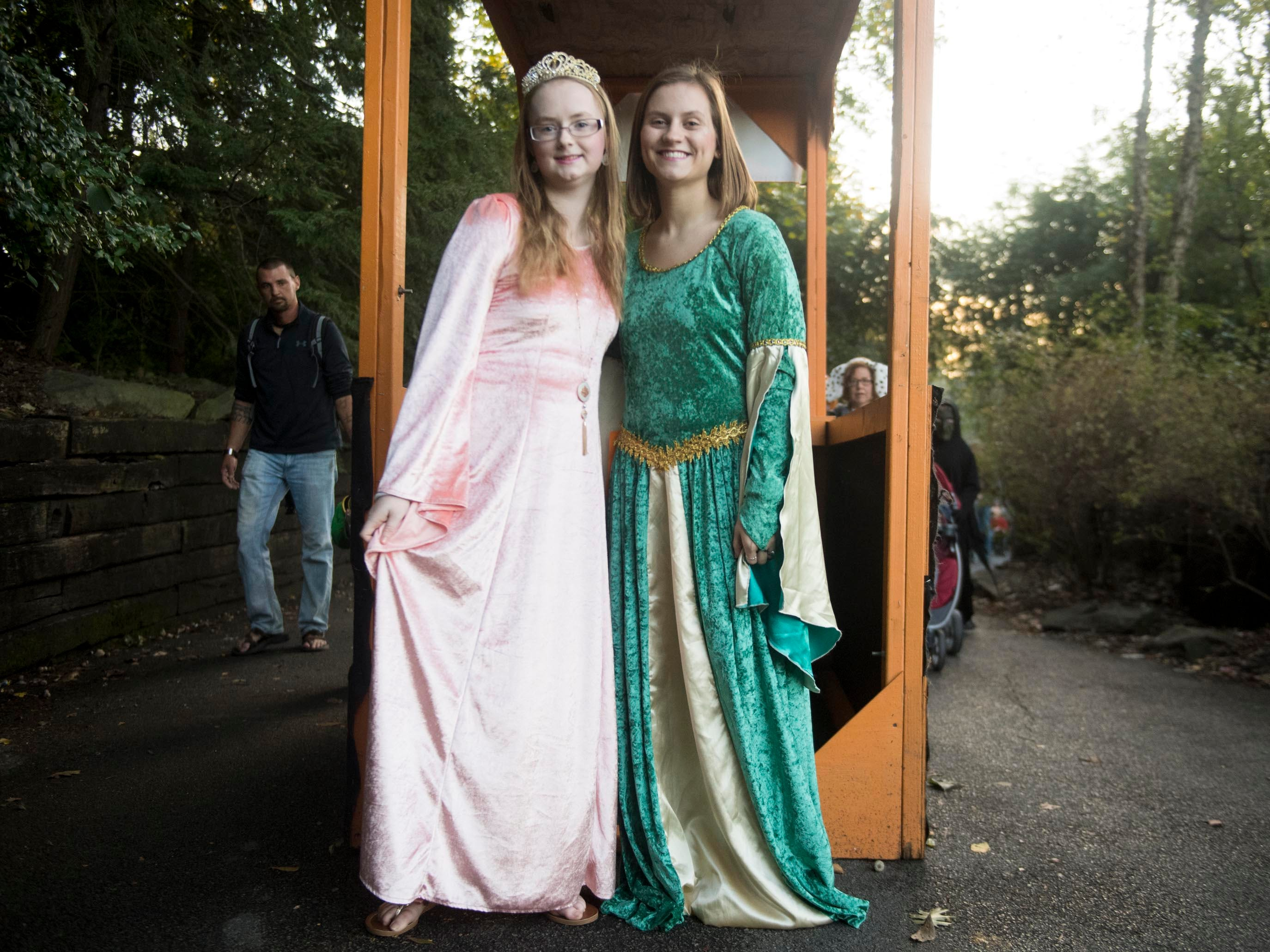 Haven Fisher, left, and Josie Grussing are dressed as princesses and handed out candy during Zoo Knoxville's Boo! at the Zoo on Saturday, October 20, 2018.