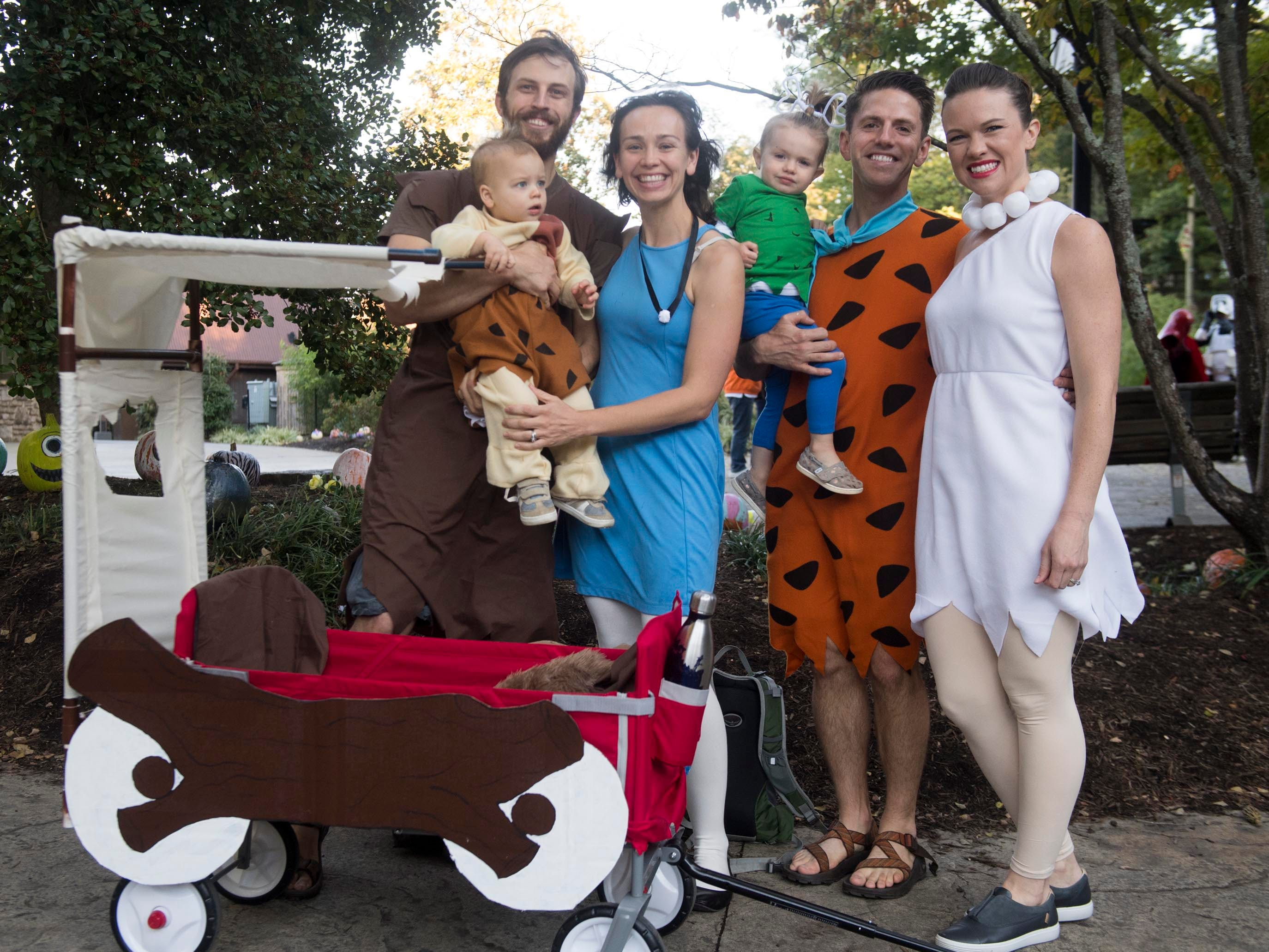 From left, Garrett, Brittany, and Fletcher Bentley with Jacob, Katie, and Eleanor Watson dressed as characters from The Flintstones for Zoo Knoxville's Boo! at the Zoo on Saturday, October 20, 2018.