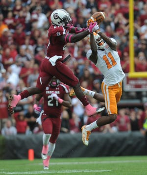 South Carolina cornerback Victor Hampton (27) makes an interception on a pass intended for Tennessee wide receiver Justin Hunter (11) late in the fourth quarter ending at Williams-Brice Stadium in Columbia, S.C., Saturday, Oct. 27, 2012.