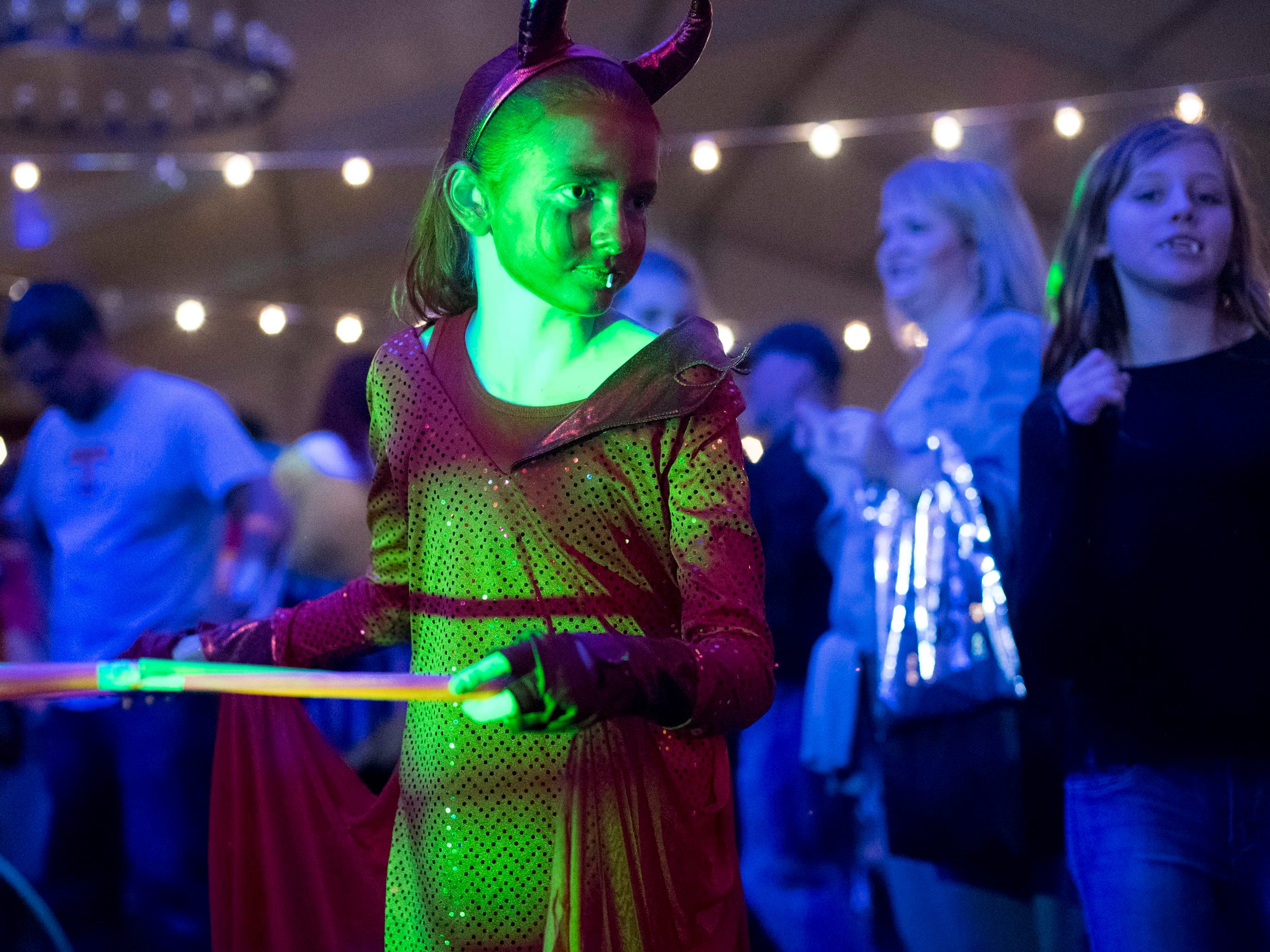 A devil costumed trick-or-treater at the Monster Mash dance party during Boo! at the Zoo on Saturday, October 20, 2018.