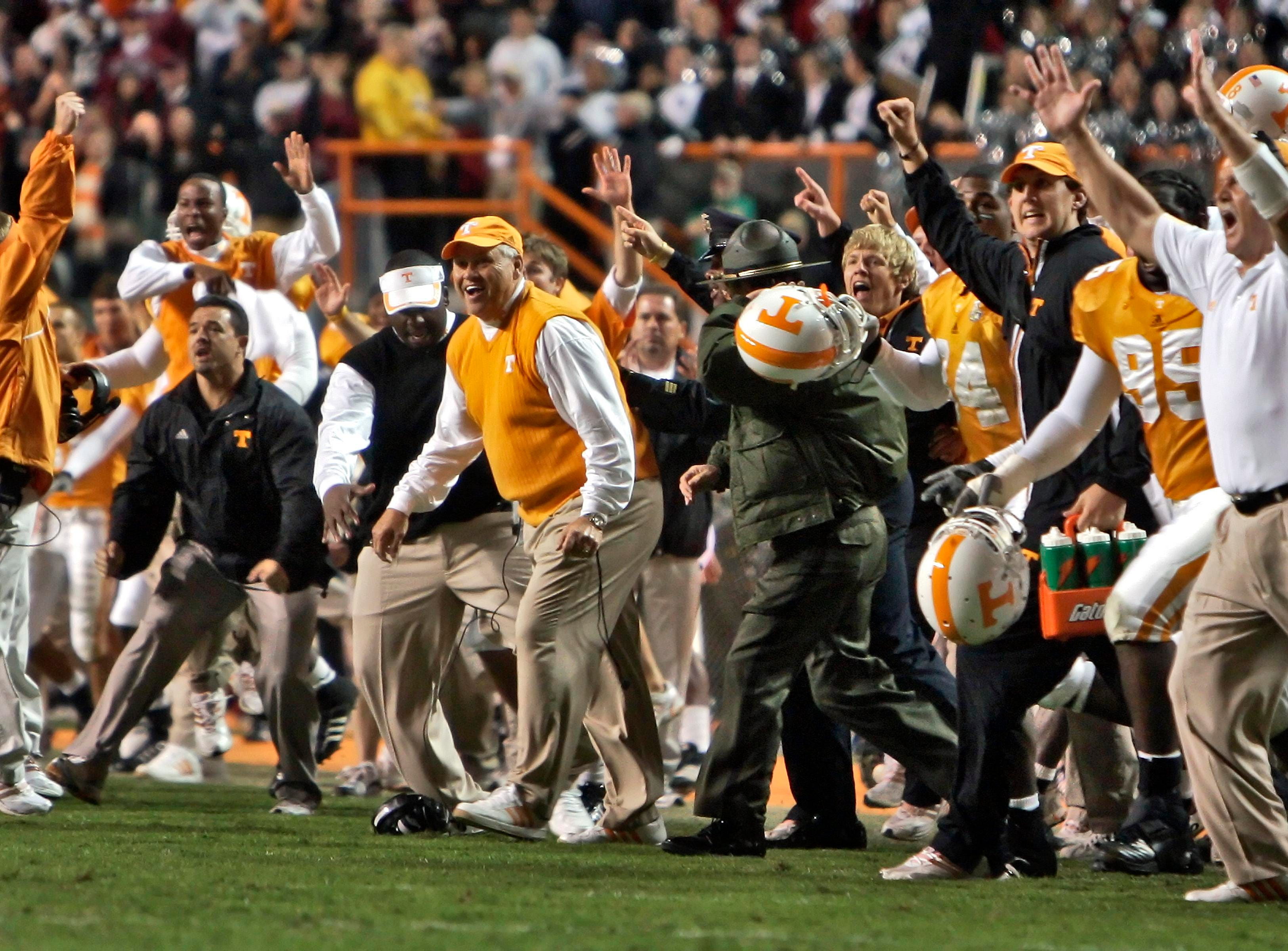 The Tennessee bench including head coach Phillip Fulmer, orange vest, celebrates after a 27-24 overtime win over South Carolina in a college football game Saturday, Oct. 27, 2007 in Knoxville, Tenn.