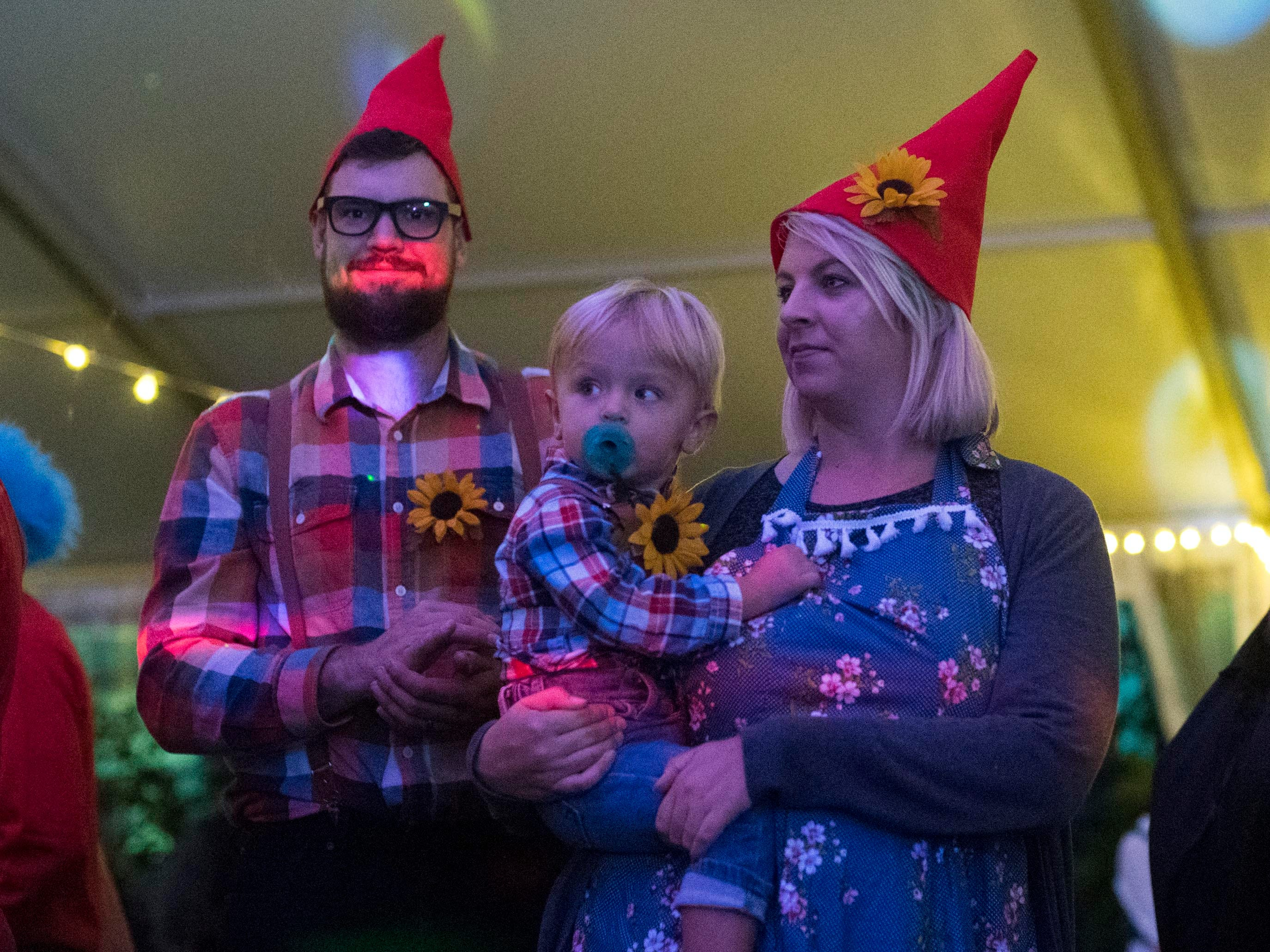 A family of gnomes attend the Monster Mash dance party during Boo! at the Zoo on Saturday, October 20, 2018.