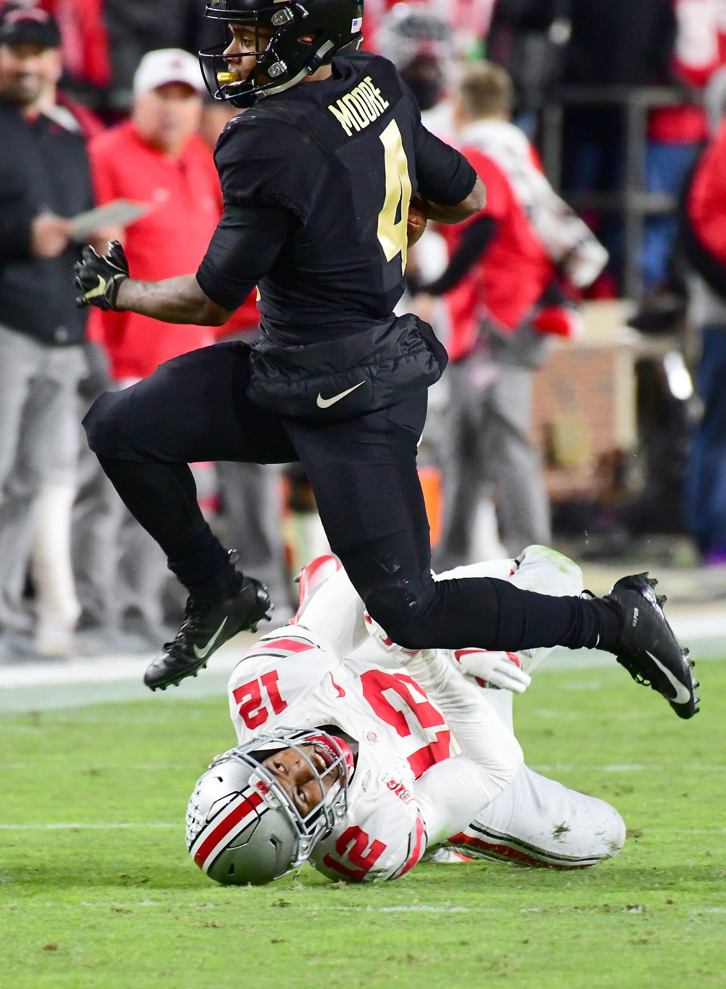 Purdue's Rondale Moore leaps over an Ohio State defender as Purdue upsets Ohio State in West Lafayette on Saturday October 20, 2018.