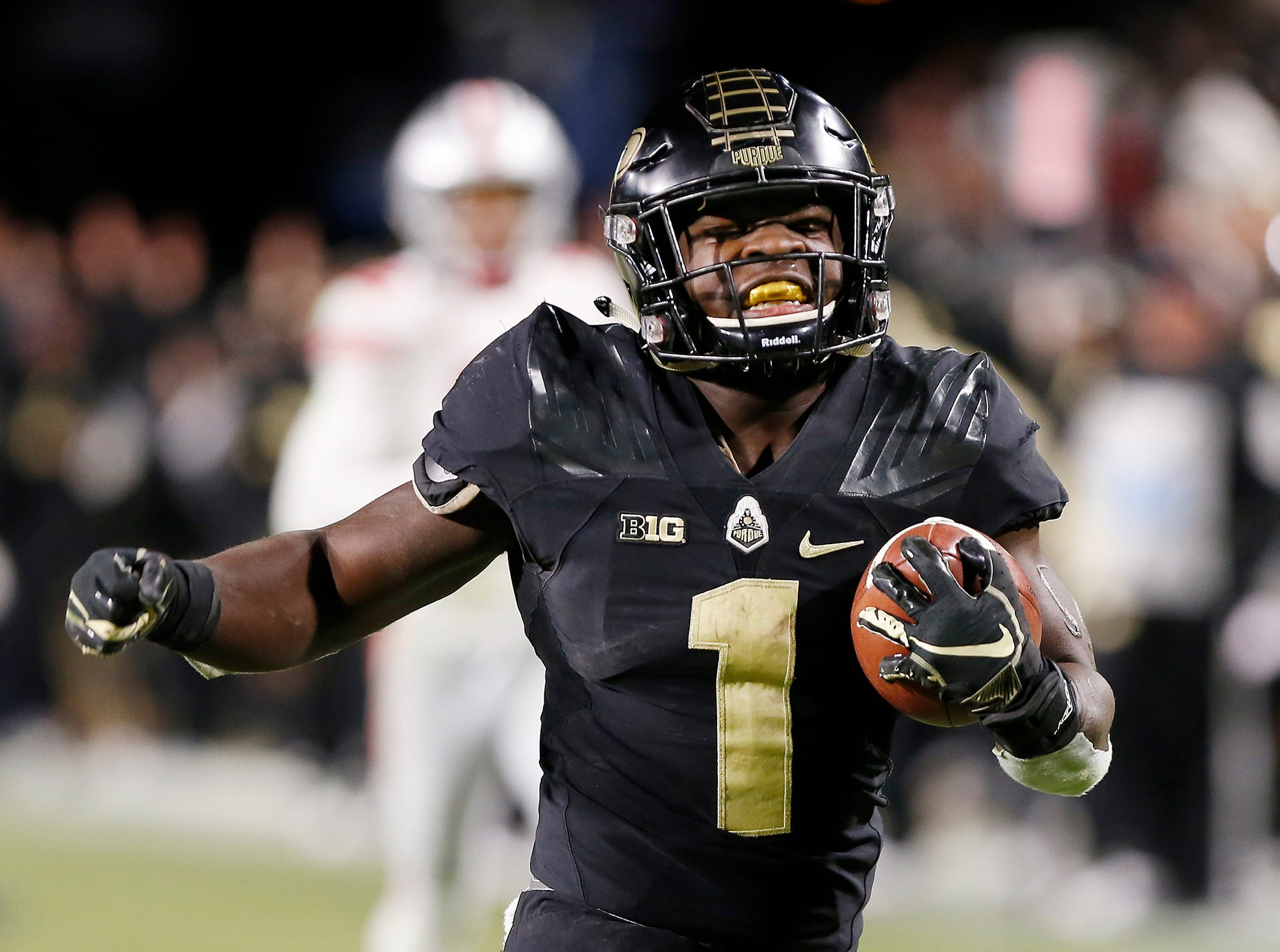 D. J. Knox of Purdue carries for a touchdown in the fourth quarter against Ohio State Saturday, October 20, 2018, at Ross-Ade Stadium. Purdue upset the No. 2 ranked Buckeyes 49-20.