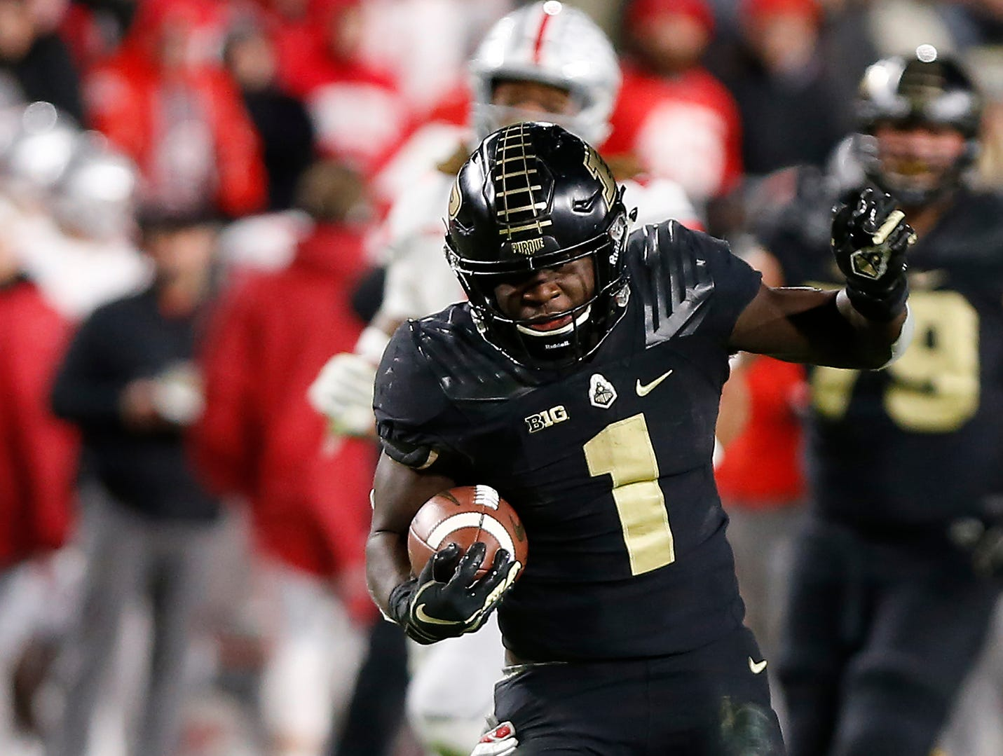 D. J. Knox of Purdue slips through the hands of Jordan Fuller of Ohio State as he rushes for a touchdown at 11:39  in the fourth quarter Saturday, October 20, 2018, at Ross-Ade Stadium. Purdue upset the No. 2 ranked Buckeyes 49-20.