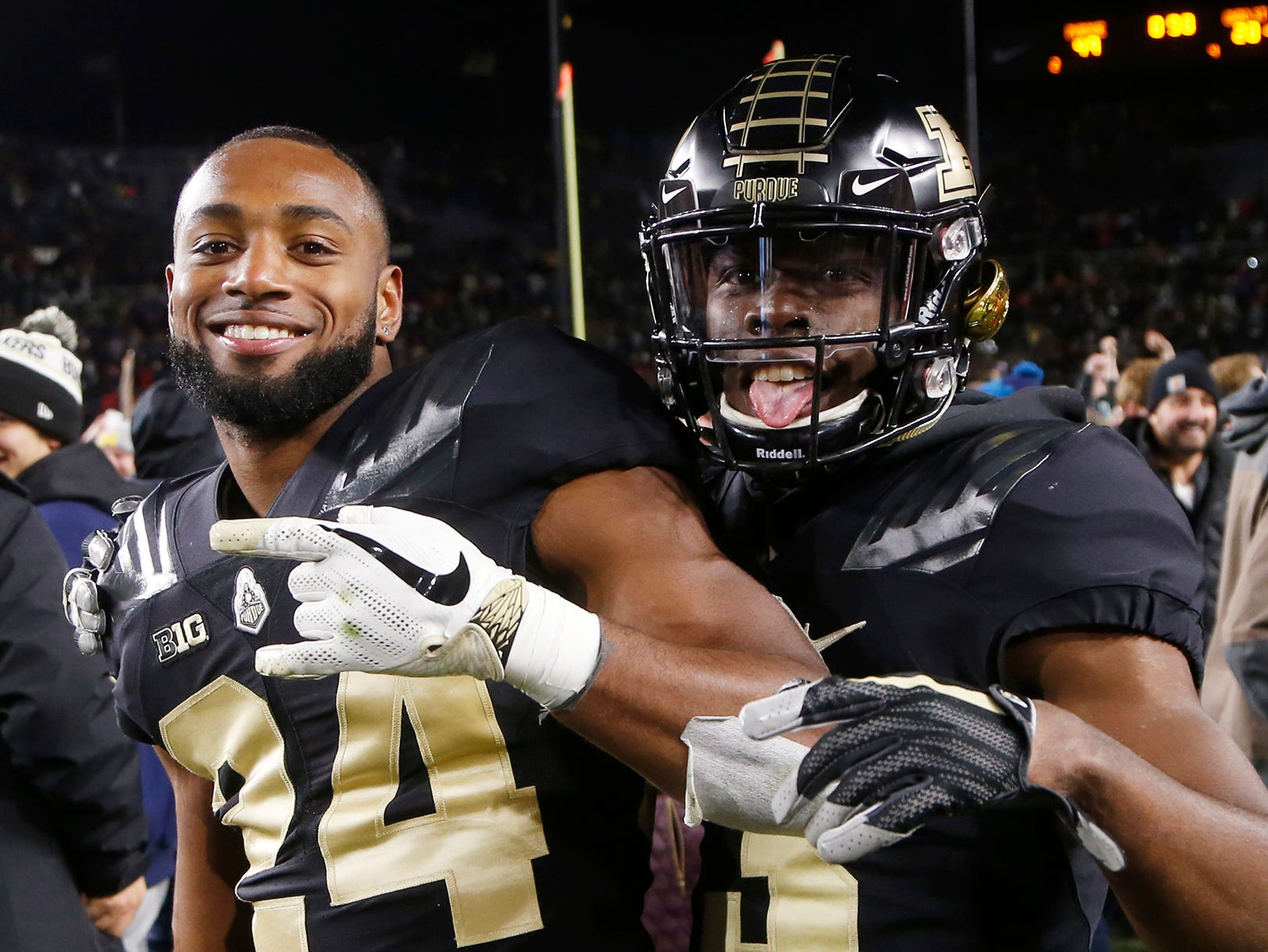 Tim Cason, left, and Kamal Hardy of Purdue join the celebration on the field after the Boilermakers upset No. 2 ranked Ohio State 49-20 Saturday, October 20, 2018, at Ross-Ade Stadium.
