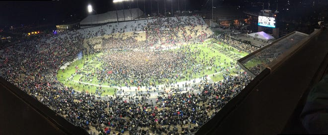 Purdue fans rush the field at Ross-Ade Stadium after the Boilermakers upset No. 2 Ohio State 49-20 Saturday night.