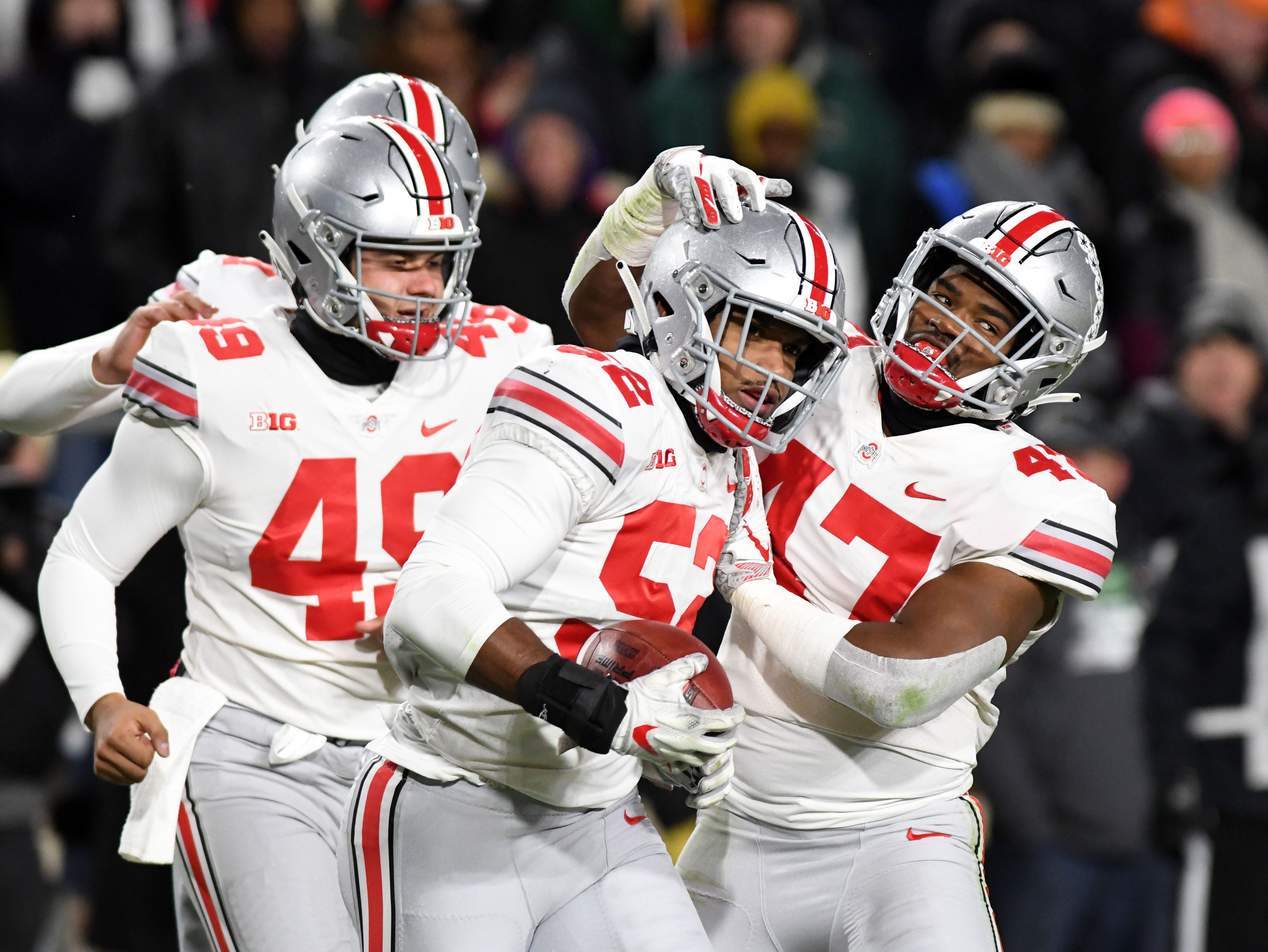 Oct 20, 2018; West Lafayette, IN, USA; Ohio State Buckeyes lineman Dante Booker (52) and linebacker Justin Hillard (47) celebrate a play against the Purdue Boilermakers in the first half at Ross-Ade Stadium. Mandatory Credit: Thomas J. Russo-USA TODAY Sports