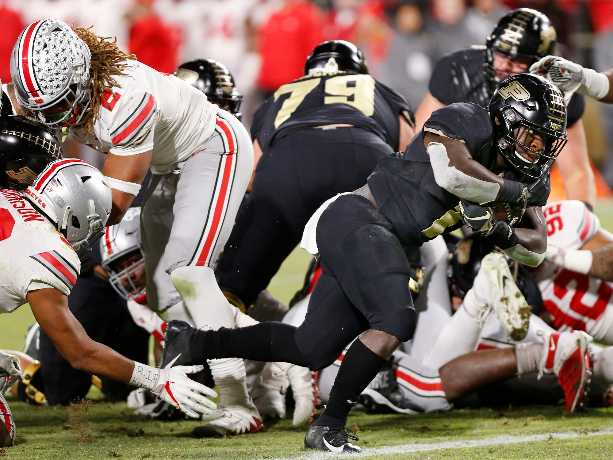 D. J. Knox plunges through the Ohio State defensive line for a touchdown at 8:36 in the third quarter Saturday, October 20, 2018, at Ross-Ade Stadium. Purdue upset the No. 2 ranked Buckeyes 49-20.