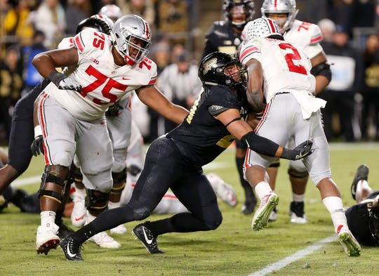 Linebacker Markus Bailey of Purdue stops J. K. Dobbins of Ohio State in the third quarter Saturday, October 20, 2018, at Ross-Ade Stadium. Purdue upset the No. 2 ranked Buckeyes 49-20.