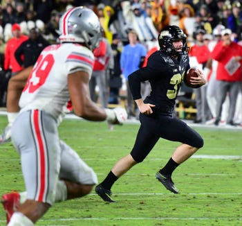Purdue's Joe Schopper gets a first down on a fake field goal attemp as Purdue upsets Ohio State in West Lafayette on Saturday October 20, 2018.