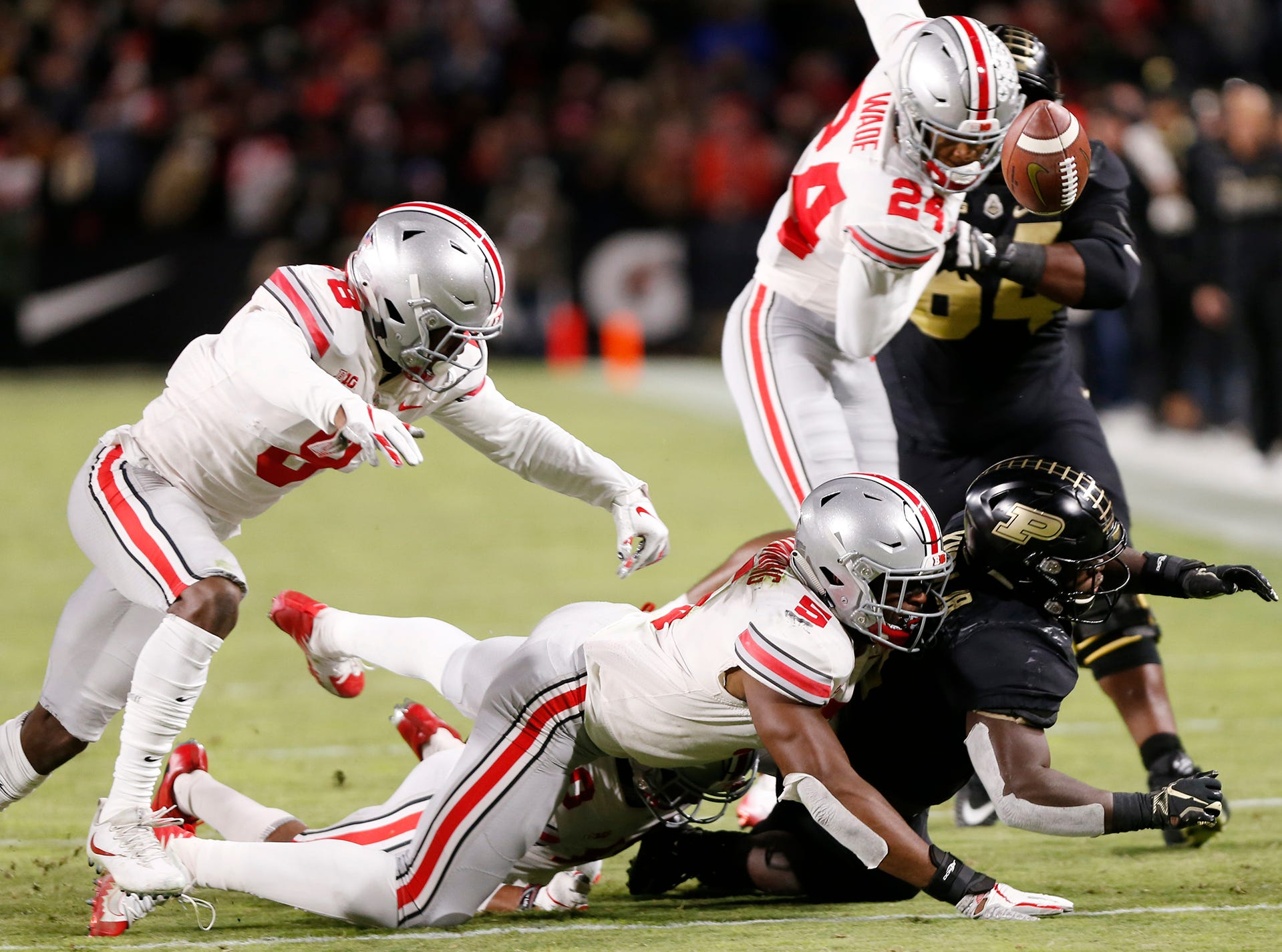 The ball pops out of the hands of D. J. Knox of Purdue as he is hit by Baron Browning of Ohio State Saturday, October 20, 2018, at Ross-Ade Stadium. Purdue maintained possession of the ball. Purdue upset No. 2 ranked Ohio State 49-20.