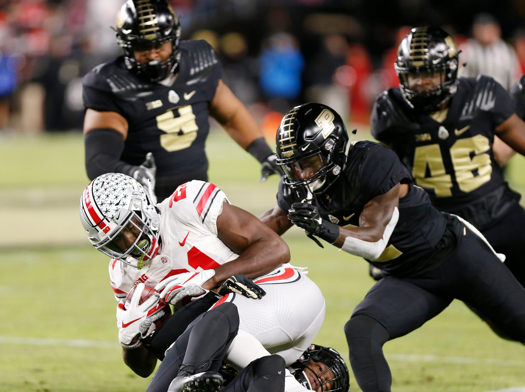 Parris Campbell Jr. of Ohio State is brought down by Simeon Smiley and the Purdue defense Saturday, October 20, 2018, at Ross-Ade Stadium. Purdue upset No. 2 ranked Ohio State 49-20.