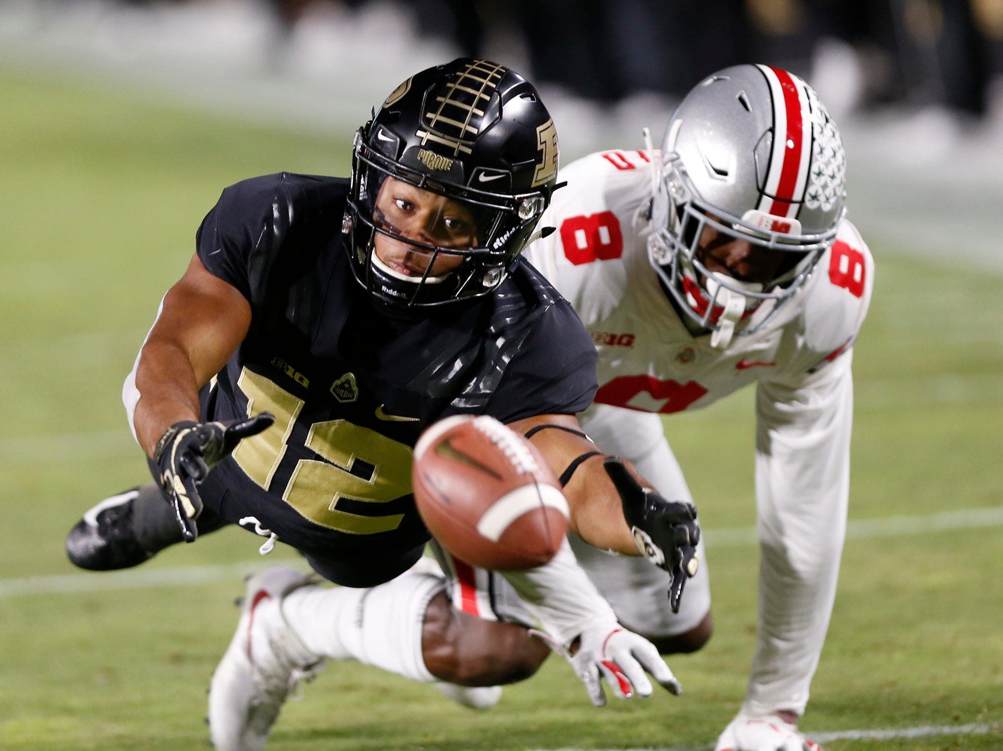 Jared Sparks of Purdue is whistled for offensive pass interference as he tries to make a catch against Kendall Sheffield of Ohio State in the first half Saturday, October 20, 2018, at Ross-Ade Stadium. Purdue upset No. 2 ranked Ohio State 49-20.