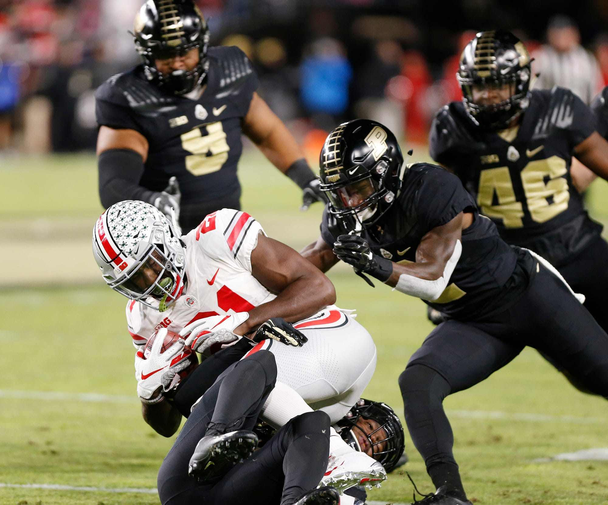 Parris Campbell Jr. of Ohio State is brought down by Simeon Smiley and the Purdue defense Saturday, October 20, 2018, at Ross-Ade Stadium.