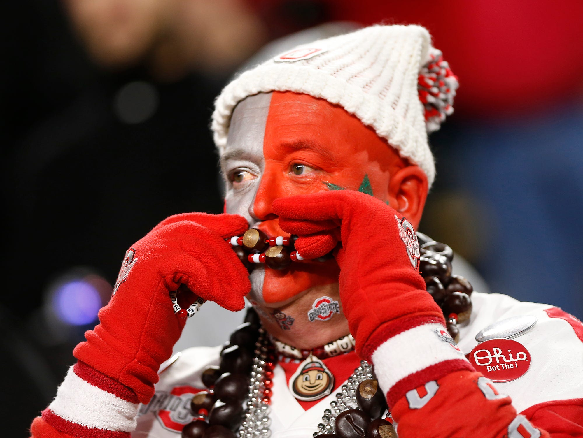 """Ohio State super fan Jon """"Big Nut"""" Peters kisses a necklace of buckeyes as the Buckeyes struggle late against Purdue Saturday, October 20, 2018, at Ross-Ade Stadium. Purdue upset the No. 2 ranked Buckeyes 49-20."""